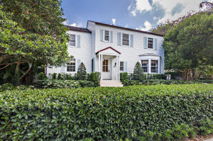 Classic Colonial designed by Maurice Fatio located on the desirable North End.  Home has undergone extensive renovations including new roof, windows, electric and plumbing.  Once you enter the home, you are greeted with amazing light due to the southern exposure of the home overlooking the expansive back yard.  The street itself has direct beach and lake trail access.  When you see this home think, Father of the Bride.