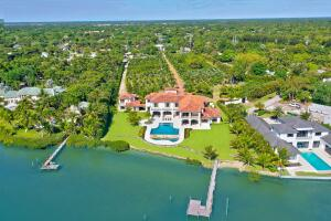 Your South Florida wish list, fulfilled: spectacular setting, design and details, plus easy entree to all Palm Beach County offers. Villa Real is the centerpiece of Jupiters 2nd-largest parcel along the Loxahatchee River, with 6.25 lush acres & rare 254 of water frontage. Built in 2016 with elegant materials sourced from around the world, this contemporary, Moorish-inspired retreat balances intimate spaces & informal flow across 18,000 SF, from the 6-bedroom, 6.5-bath Main House to the Lanai and bi-level pool to the full-service 2-bedroom, 2-bath Guest House. Smart technology integrates operations for comfort & convenience and makes working and schooling from home a breeze. Come experience Villa Real and imagine it as your private compound or see the possibilities.