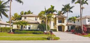 Located in very desirable and prestigious Isles of Wellington, this six bedroom six bathroom Sedona home has a spacious floor plan. Featuring great amenities, high ceilings & an abundance of windows,  detailed crown molding, recessed lightin. For the perfect Florida life style, this home offers a large Master Bedroom. Large covered porch with pool and lake view that offers for a great private backyard. Near great Equestrian activities and schools.