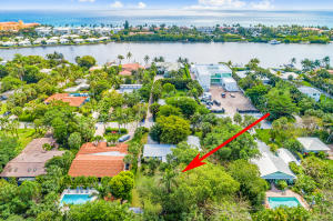 Rare find; never before on MLS. Build your dream home & live the good life on tropical Hypoluxo Island! Some of the current home/shell could possibly be used/extensively renovated but should be razed to fulfill the amazing potential of the expansive 15,500 sq. ft. lot (100x155). Being sold as a tear down. Located on a natural island within the Intracoastal Waterway nestled between Manalapan & South Palm Beach, Hypoluxo Island offers luxury along with the charm of a small town. Ride your bike to Lantana beach & fantastic local restaurants. Minutes to Eau Palm Beach Resort & Spa, Plaza del Mar shopping center & more. Enjoy a scenic drive along A1A to Palm Beach/Worth Ave. or Delray Beach/Atlantic Ave. Conveniently located, yet away from the hustle & bustle of the city. Paradise awaits...