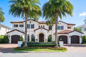 230 South Maya Palm Drive is a 5-bedroom waterfront SRD Signature Estate featuring warm contemporary and clean-line design, with fine custom details and one-of-a-kind finishes. The stunning front entry includes a lofty and welcoming two-story foyer. After you enter the solid mahogany door, elegant imported marble seamlessly traverses the first floor leading your eyes to the incredible views of the pool and waterway. The great room is flanked by a stunning natural gas fireplace, and an elegant dining room with deeply coffered ceilings. The gourmet kitchen is outfitted with two granite-topped contrasting islands, custom wood and window-backed cabinets, top-of-the-line SubZero and Thermador appliances, and opens to the family room for inclusive entertaining. Family and friends will love