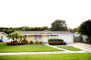 This is a gem of a home located in Tequesta Florida! An oversized lot and newly landscaped lawn welcome you home. The yard is fenced and completed by a fire pit and storage shed. There is a separate storage driveway for your toys, boat, trailer or RV we will leave that up to you! Freshly painted with a brick paver driveway and screened patio with access to the separate laundry room. The kitchen has been updated with stainless appliances to top it off.  Three bedrooms with deep closets/storage areas above. Popular tiled floors throughout the living areas! Martin County Taxes.....Dont miss out on this one!