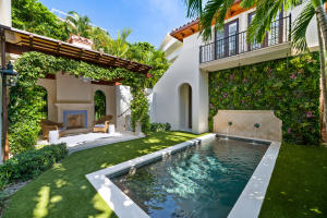 Pure Elegance. In-town living. This 2016 Pat Segraves designed home is the perfect spot for enjoying Palm Beach to the fullest. Walk to Worth, the Four Arts, the beach and Town Docks. The Lake Trail and the new Nievera Williams landscaped park along the intracoastal are literally steps away. Two bedrooms plus study upstairs and a beautiful guest suite above the two-car garage. Elevator, full-house generator and an inviting salt water pool. Move right in. Theres nothing missing!