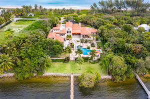 Escape to your private compound and enjoy the best of both worlds. Extraordinary opportunity to renovate or create your own private estate on approximately 2 acre waterfront parcel with  water frontage totaling 300. (150 on expansive Intracoastal waterway and 150 of oceanfront) Property boasts of a wide private beach, the ability to renovate or build a new 1000 SF cabana plus 250 SF of decking, and existing large dock. A 11,953 living SF  residence with multiple terraces and large pool currently exists on the property.