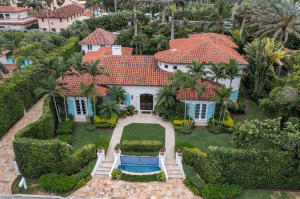 Enjoy this beautiful mediterranean 4BR/5BA home with 1BR/1BA carriage house in the Estate Section with waived Mar-a-Lago initiation fees.  The lushly landscaped exteriors include heated pool and spa, private beach access, built-in BBQ and gated drive. Interiors are professionally decorated and include gourmet chefs kitchen, formal dining room and large living room with fireplace.  The elevator provides additional access to upstairs master suite with his and hers bathrooms and closets.