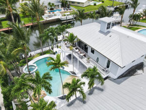 Charming Key West home in the Heart of the Village of NPB boasts 4 bedrooms,4 baths, pool & spa, lush landscape and palms. New private dock w/electric 12,000b lift, 75 waterfrontage. Spacious master suite & many upgrades Included in this home. Take your friends & family for a sunset cruise on your boat to unwind from the day or just minutes intracoastal/ocean. NO HOA FEES.Close proximity to the new North Palm Beach Country Club with Farmers Table restaurant, Jack NicklausSignature18 hole course & driving range, olympic size swimming pool, tennis courts,  newly renovated Anchorage Park & Marina which includes enclosed dog park, volleyballl courts, and childrens playground area.Your new waterfront paradise awaits.