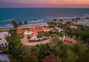 One of Gulf Streams most iconic oceanfront estates sited on 200+/- of pristine pink coral sand, 2817 N. Ocean Blvd. Gulf Stream, Florida is an exquisite oceanfront compound with sweeping views along the Atlantic Ocean which has recently been updated and reimagined.  The estate offers a rare opportunity for a buyer or investor to own a sliver of paradise. This original 1926 oceanfront estate was rebuilt by award-winning architectural firm Bridges and Marsh featuring the finest of finishes and details from around the world. Gracing this 12,623+/- estate is an expansive floor plan which includes 7 beautifully appointed bedrooms, 10.4 baths, and 3 guest villas. Outstanding details include Tischler impact windows/doors, imported marbles, limestone floors, cypress cathedral ceilings, Paris