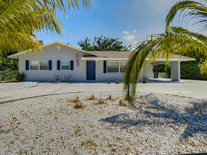 Sold fully furnished. A/c & water heater 2016. Looking to start Airbnb, look no further. This beautiful 4 bedrooms /3,1 baths. Located 1/2 to the beach and boat ramps as well as some of the areas best dining! Bring your boat and park it in the oversized driveway/boat parking area. Juno Beach Boat Launch is just down the street! This home has it all. Newly updated featuring white cabinets and white solid surface countertops, wood laminate flooring throughout. The home features 3 King beds, 2 Twin Beds and 2 Convertible Couches. All linens/dishes/Pots/Pans etc. supplied to make this a perfect turnkey experience. We are 25 minutes to Palm Beach International Airport and just 5 minutes to the Gardens Mall. Less than a mile to the beaches and state park