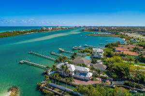 Breathtaking views from this beautiful Key West style 4 bedrooms, 4 baths, 3 car garage including guest house, pool home on the turquoise blue Intracoastal Waterway with unobstructed views of Jupiter Islands Blowing Rocks Preserve across the ICW. The property is situated on a point lot accessed via a private 350 ft road that leads to gated entry and is a point lot on the Intracoastal with 300 ft of water frontage and interior lagoon. Open floor plan concept with volume wood ceilings, lots of windows and natural light, and panoramic views in all rooms. Island kitchen with custom cabinetry, granite counters & stainless-steel appliances, crown moldings, elevator, a whole house generator,  guest house with separate entry over garage and wood flooring & tumble marble/porcelain tile throughout.