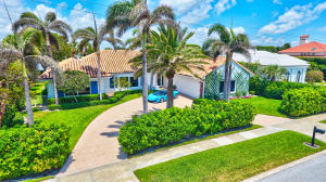 Classic Bermuda style home with panoramic views of Manatee Cove in the highly sought after enclave of Point Manalapan . This stately home with almost 4000sf of living space offers generous room sizes, high ceilings and a bright, open floor plan that lends itself to easy entertaining. All en suite bedrooms with large baths, cabana bath & walk-in closets. With 110 of water frontage, enjoy expansive views from living areas and master bedroom. Gorgeous backyard and pool area with large lanai. Easy access by boat to the Intracoastal and just minutes to the ocean inlet. Property offers privacy and seclusion located on a cul-de-sac street and manned entrance to the community. Gratis membership to La Coquille Club at the Eau Resort. Manalapan is a truly unique town of unparalleled beauty.