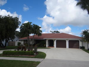A real rare find in Royal Palm Beach. 3 bedroom 2.5 bathroom pool home with fantastic canal and golf course views. Oversized living room and den will give you plenty of room for entertaining. Split bedroom plan, solar hot water, cabana bath, oversized interior laundry, accordion shutters and much much more.  This home will not last long.