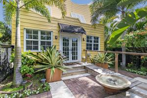 Circa 1924, enjoy peace of mind in this rare home outside of flood and evacuation zones knowing each door and window is hurricane protected. And enjoy rare convenience, only an eight minute walk on a wide avenue to unique shops, restaurants and an intracoastal park with boat access, and an easy waterside bike ride to downtown West Palm and Palm Beach Island. Set minutes between two hospitals, PBI airport and I-95 are a short drive. This gated propertys comprehensive renovation maintains passive solar design, Pecky Cypress ceilings, Dade County pine floors and includes front/back wheelchair access, garden, exterior artwork and furniture designed for the property.