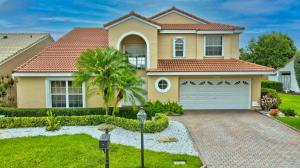 This home has it all. Roof replaced 2013, AC replaced 2018, hurricane shutters or impact glass on all windows installed 20/21. Beautiful expansive long lake views. Windows have 3M Sun shades to protect from FL sun. House is situated next to community pool great for FL living. Redone kitchen w/stainless appliances & granite tops. Washer & dryer new. Master bath redone w/frameless shower door, stone work and soaking tub. Custom cabinetry in kitchen and bath. White tile in living area custom designer carpeting on stairs and bedrooms. 2nd refrigerator in garage conveys. This pristine house is move in ready and offers volume ceilings and crown molding. Tropical landscaping surrounds this home. Costa Del Sol is a very well kept community. The exteriors of all homes have just been painted.