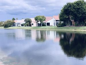 5/3.5 Lovely Lakefront Home, NEW 2020 ROOF!! Light, & Bright with beautifully renovated gourmet kitchen open to family room.. Master down has two walk-in closets, duel vanities, soaking tub, separate toilet. Four bedrms + Loft upstairs. Immaculate with gorgeous lake views, beautifully landscaped extra huge lot. HOA Includes: lawn service, internet, cable,24hr manned gate, Newports New 2021 State-of-the-art Fitness Center & Clubhouse. Beautiful Resort Styled Pool with marble decking,  sauna, 8 lighted, har-tru tennis courts, staffed pro shop, heated lap pool, New playground, yoga, water aerobics  social groups+ NO EQUITY, NO DUES,  Centrally located, minutes to beaches, shops, fine restaurants, Town Center Mall, famed Atlantic Ave. Walk to Starbucks! All A-Rated Schools. NICE!