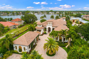 Boasting over a 135 OF RIVERFRONT AND STUNNING PANORAMIC WATER VIEWS OF THE LOXAHATCHEE RIVER, this private single-story grand estate is a true masterpiece.  Set on an EXPANSIVE 1 ACRE PARCEL and located on sought-after Riverside Drive, this 10,000+ sq. ft. home, was BUILT EXCEPTIONALLY WELL IN 2009 with HIGH QUALITY CRAFTSMANSHIP AND ATTENTION TO DETAIL. Upon entering thru the private gates, you feel welcomed to this spectacular property and attractive home that features 4 spacious bedroom all with on-suite bathrooms, an office, 2 dining rooms, 2 PROFESSIONAL INDOOR BOWLING LANES, a guest house with kitchenette and separate garage.  (See supplement for more details).