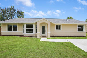 3/2 CBS SFH  sitting on 1.19 acres land. Inground pool.Exterior Features:- New Roof installed June 2021.- New Reverse osmosis system for the entire house.- A/C 2 years Old - Electric Water Heater 2 years old- Salt water pool - Detached Garage is 30 x 40 1200 sqft 14 ft high with 2 - 10 ft roll up doors front and back and 1 side door. -Water softener for the pool.-Solar power with a battery automatic gate opener.Interiors Features:-Freshly painting inside-Tile throughout the whole house Master bedroom laminated floor.- Master bedroom two walk in closet-Upgrade Kitchen and bathrooms-Kitchen has night lights LED built in the outlets-Seller is leaving 2 guest bedrooms TVs, a pool table and ring door bell.Septic tank was drained in 2020, property is