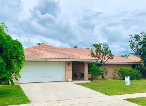 Located near Wellington equestrian facilities and close to shopping malls, restaurants. This CBS home is centrally located in Wellington. Non-HOA community. The house has a split floor layout:  2 bedrooms on the left side of the house, and the master bedroom on the right side of the house, 2 bathroom. Large pool with patio area facing the canal. Kitchen includes granite counters, stainless steel appliances, casual dining. Central vacuum. Tile Roof. Sprinkler System with canal-fed water. Pool was resurfaced 2 years ago.
