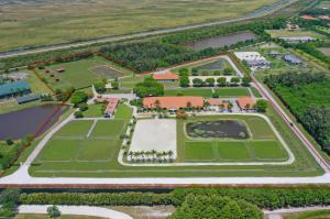 Private 20 Acre horse farm with 37 Stalls! This beautiful farm functions across all disciplines with 3 separate stables, 2 outdoor jumping arenas, covered riding arena with mirrors with viewing pavilion, 22 grass paddocks, 2 studio apartments, one 1Br/1Bth apartment & 3Br/1Bath owners apartment, all peacefully nestled up against the everglades with an end of street location! The property also boasts: owners lounge, air-conditioned feed rooms, 6 horse euro-walker, stallion paddocks, round pen, 3 RO systems, 80 KW Kohler diesel generator and 3 RV hookups. The back 5 acres is all pastureland with four 12 x 24 run-in sheds & 4 stall ctr-aisle pole barn with water & electric, all of which are bonus stalls in addition to the 37 stalls in the show barns!