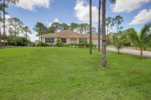 Stunning CBS ranch style home located in the great area of Loxahatchee. Starting on the outside this home is perfectly located in a Large Corner lot with 1.37 acre of land. In the interior you will find 4 bedroom, 2.5 baths, 2 car garage, formal dining room that could be use as an office or turn it into another bedroom, great room with eat in area. The kitchen has beautiful white cabinets, granite countertops, stainless steel appliances, separate laundry area, covered patio, two walk in closets in the master bedroom, dual sinks, shower and tub in the master bathroom, ceramic tile through the main areas, carpet in three of the bedrooms and wood laminate floor in the master bedroom, extra storage area in the garage, water softener, plenty of room for a pool in this magnificent back yard.