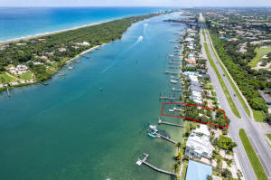 Location! Location! Location!Lot measures 100 x 106.23 acresBuild your dream home on the intracoastal waterway with 100 of blue water frontage.Two  private docks.White sandy beaches at low tide. Tropical backyard with panoramic water views of the Intracoastal Waterway and Jupiter Island.No fixed bridges. Minutes to the Jupiter Inlet, Tequesta and Jupiter Sandbars and Harborside shopping and dining.Two island style bungalows currently on the property with a separate sauna room, shower and bathroom. Florida lifestyle at its best. Close to beaches, dining, entertainment and recreation. Easy access to major highways and Palm Beach International Airport.