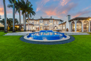 This Flawlessly Stunning fully furnished residence is the epitome of Luxury Estate living, with the finest south/southwest cul-de-sac waterfront location in a community of gorgeous one acre estate residences.   See More for full details.