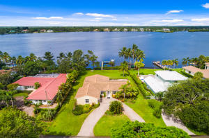 Spectacular riverfront home on the widest part of The Loxahatchee River and great elevation in highly desirable Tequesta Country Club.  This CBS Single-story residence with 4 bedrooms, 2.1 baths, 2 car garage pool home has a split open floorplan, high ceilings, dock with boat lift and is priced at land value!