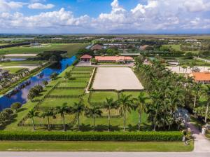 Location, Location! This Palm Beach Point East equestrian property has it all. Situated on 5 acres with 2 barns and 23 stalls this is a real horsemans property with a solid rental history. Mature landscaping with a canopy tree driveway leads you to the barns with ample parking. There are 2 air conditioned tack rooms & feed room accompanied by a riders lounge, bathroom and 2 sets of washer/dryers, 4 grooming stalls and 4 wash stalls. Both barns have complete fly systems, fans, and comfort stalls in main barn. The 132 x 270 riding arena with GGT footing is graced by a comfortable viewing area. The 9 large irrigated paddocks have privacy hedges. The owner/staff quarters includes 3 bedrooms, 1 bathroom, full kitchen with dining and living areas.