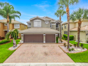Beautiful Avalon Model in prestigious Nautica Isles West featuring 5 bedrooms, 6th bd/office 1st fl, New A/C 19,  completely fenced in with partial lake views , pool resurfaced with new tile in 20, 2nd floor deck/balcony replaced 20, all new laminate flooring in 17, new  kitchen tile backsplash in 20, new stainless steel appliances, double kitchen sink & garbage disposal all in 17, new water heater in 2017, new solar panels in 2020, all new recessed lighting replaced in 2020, new stained glass entry front door with new lock and side light in 20, accordion shutters on 2nd fl 20,  exterior painted in 17, double paver driveway & front walkway, patio/pool area power washed in 20, 9ft ceilings on 1st fl, archways, lake fed sprinkler system, ,beautiful lanai with view of inground pool
