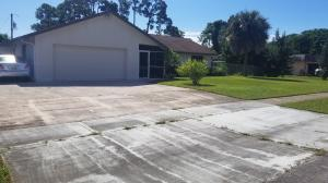 QUIET END OF THE ROAD PROPERTY FENCED LOT, ALMOST 1/2 ACRE AT DEADEND OF BROWARD AVE ON CANAL, NO HOA, 2 SHEDS, , FLORIDA ROOM WITH CYPRESS CEILING AND WET BAR, HUGE CEMENT SLAB WITH ROOF FOR ALL YOUR TOYS, BOATS, CAMPERS AND CARS.
