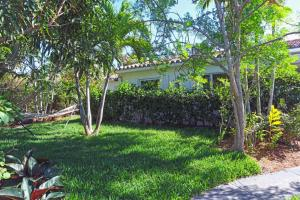 This charming and newly renovated beach cottage, located on the beautiful north end of Palm Beach, features 4 bedrooms and 4 baths and is only steps away from the water. The lovely one-story home includes a quaint loggia to spend cooler evenings in, a private pool, two fireplaces, gorgeous hardwood and marble floors, and driveways for 2 or more cars.  Whether you want to go and spend some time at the beach right outside your front door or just relaxing in your private pool , this beach cottage can be your next dream home.