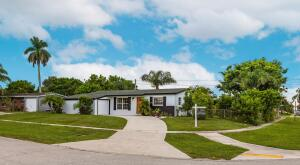 Beautifully renovated home with rare 3 BEDROOMS & 3 FULL BATHS!  Close to all the shopping, Gardens Mall, Whole Foods, Traders Joes and near I-95. No HOA. Great home for a family with large backyard and side yard on this fantastic corner lot. Great to store RV or a boat. Indoor garage and plenty of room for a pool. Must see.