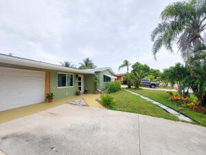 3 bed/2 bath fully remodel CBS home. 1346 sq. Ft. of leaving space including 1 car garage, plus additional 300 sq. Ft. cover & tiled back patio. 2 miles from Lantana beach in a residential neighborhood. Home has a guest suite with its own bathroom, wet bar, laundry closet, fenced patio and separate entrance, ideal for renting & extra income. Property has all impacted windows & doors. New/2020 Duct work & HVAC unit, UV light. New tankless water heater. Home Freshly painted, all bathrooms and kitchen remodel. Stainless steel appliances, granite top. Full laundry room, porcelain & engineered wood floors throughout. Beautiful outdoors: front yard with porch & sprinklers; back yard with patio, fence and landscaped. Home was tented last year, no termites or pest. Double driveway.