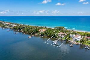 Rare oceanfront opportunity in Palm Beach County! In addition to 150 of direct ocean and Intracoastal frontage, this 5 bedroom home features movie theatre; elevator; summer kitchen with pizza oven; 60 salt water lap pool & spa; new dock; two boat lifts (25 ton & 15 ton); wet slip for 70 boat; dredged for deep water dockage (8 at low tide); 6 car garage; full house gas generator; Control 4 automatic system; and impact windows & doors throughout. Truly the best of both worlds with private beach and deep Intracoastal dockage minutes to ocean access. Centrally located between Palm Beach and Delray Beach, Manalapan has its own town hall, library, police department with patrol, and gratis membership to La Coquille Club at Eau Palm Beach Resort & Spa. A South Florida Waterfront Paradise!