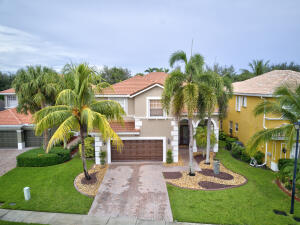 Your dream home awaits. This is a beautiful 4-bedroom 2.5 Bath home located in the resort style community of Wellington Shores. Pull into the driveway and into your 2-car garage. The exterior of the home is freshly painted, has gutters around the home, and accordion shutter on 2nd level which make hurricane prep a breeze. The large backyard is fenced on all sides w/ privacy hedges along the neighboring properties and offers a large freeform Pool w/ attached spa, a screened patio, and dont forget about the outdoor shower to rinse off before you head back into this dream home. The main entry to the home has a covered porch where the grand double doors are waiting to lead you into the formal living space which has 20ft ceilings and designer details including crown molding which can be found