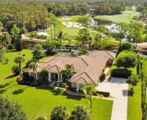 This home with guest cottage sits on a 1-acre lot that offers unobstructed views of the Dye Preserve Golf Course. Located in Martin County just west of Jupiter, FL, at the Links subdivision of Ranch Colony, a gated community with 24/7 security. Minutes to the FL Turnpike and I-95 and 10 miles from the beach. This home offers a split floor plan with an expansive master suite and office on one side, a spacious, open common area in the center, and a private 3BR/2B suite on the opposite side. The property features a 3 car garage and heated pool and spa powered by a 10,000 gallon propane tank. The guesthouse, just steps away under a covered walkway from the main house, includes 1BR/1B, a living area, and a kitchenette. This property offers incredible opportunities for multi-generational living.