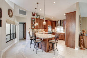 Serene 2013 remodeled 3/2 golf course home overlooking the lake. Enjoy the tranquility from the open kitchen that flows into the living, dining room and private pool with screen patio. Master bedroom with XX Large walk in closet, master bath updated with roman tub,  dual sinks, and large open shower, two additional bedrooms, 2.5 baths,  and cathedral ceilings.  Country Club Lifestyle with optional membership.