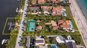 Magnificent direct ocean and intracoastal estate with a sprawling 150 feet +/- of beach frontage and almost 400 feet of depth allowing expansive outdoor space and privacy. This one-of-a-kind custom estate includes 5 bedrooms, 6 full and 1 half bathrooms along with a guest house. An entertainers dream complete with open living areas, home theater, billiards room, artificial turf with 18-hole golf and tennis court. Breathtaking gardens with outdoor water features and seating areas, dining area, and oceanfront loggia with an infinity pool overlooking the Atlantic Ocean. Recent updates include the seawall, pool, fountains, dock, and gate. Brand new geothermal system on the 8 heating and cooling units.