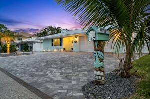 The rarest of opportunities! Home is completely remodeled, sits on a 75 new dock w/ no fixed bridges & minutes to the BB inlet & Beer Can Island.  Step inside to find your expansive floor plan & immediately notice the sprawling views of the water, pool, & dock. Your open kitchen comes equipped w/ stainless steel appliances, waterfall countertops, custom cabinetry & a built-in eating nook. Your dining room includes a wet bar w/ a wine cooler/ice maker & walk out the impact sliders to your private outside oasis. Large master features a fireplace & walk-in closets. Enjoy a brand NEW roof, water heater, whole home generator, FULL Impact windows/doors, & new ductwork. Located in Hypoluxo Point, a NO HOA neighborhood making this the ideal home for boat lovers, families, or Air BNB investors!