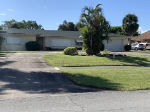 PRICED AT LOT VALUE WITH WATER RIGHTS AND NEWER DOCK IN PLACE. House is tear down or total remodel.