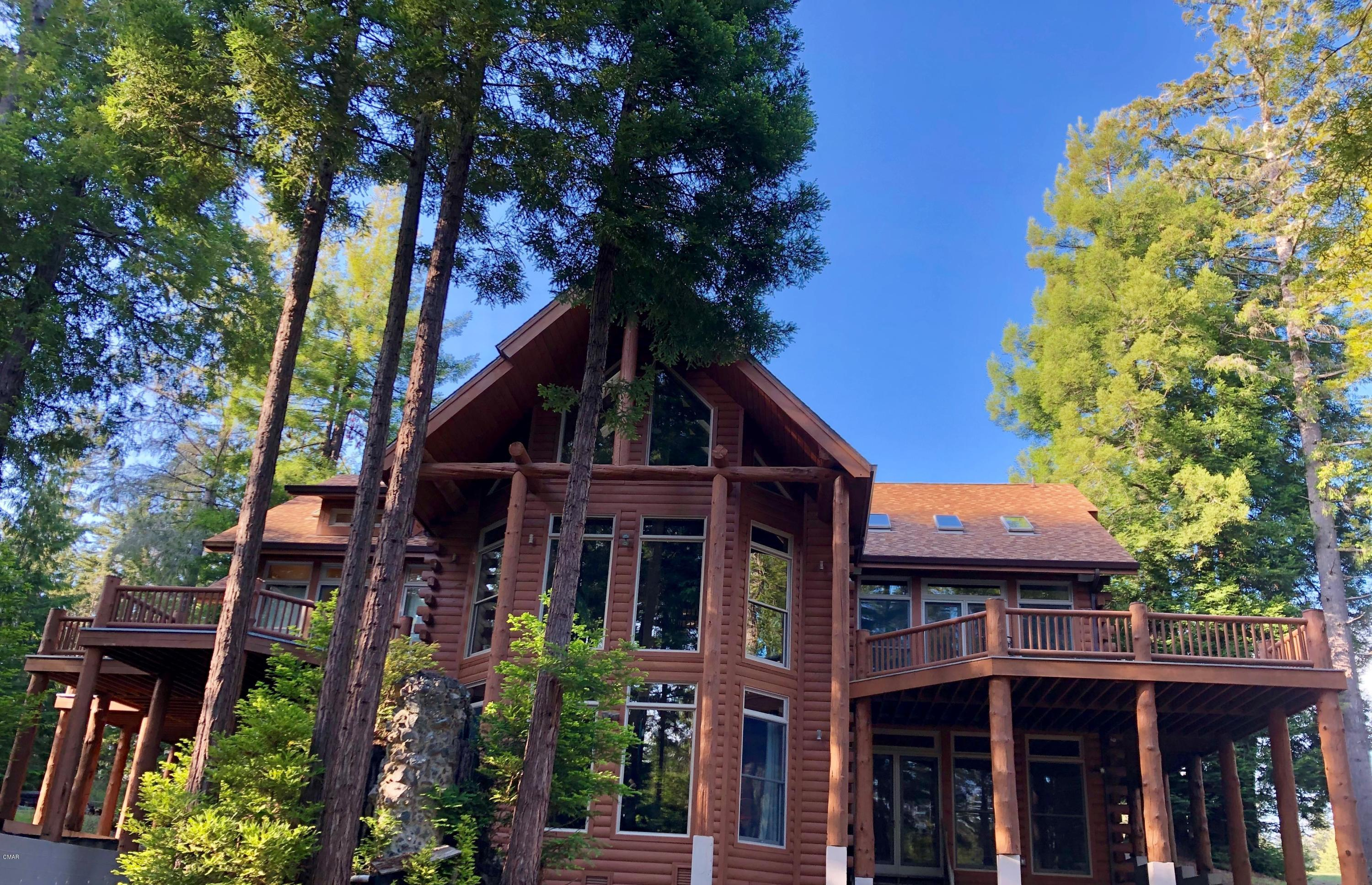 Custom state of the art smart home in the sunbelt off Hwy 20. This multigenerational hybrid log home (logs on the outside, conventional building on the inside) was designed for two families. The home can be a full time home or a family retreat, with unlimited potential to host and entertain friends and family. Fully automated and programmed with award winning Control4 home automation system. The owners can remotely monitor and control the home from anywhere in the world from their mobile devices or iPad. Lighting, security, climate control, entertainment, intercom, light and water sensors, automated shades, motorized skylights, enterprise WiFi, distributed audio, and a dedicated THX surround sound theater makes this custom home one of its kind on the coast. This beautiful six bedroom, four