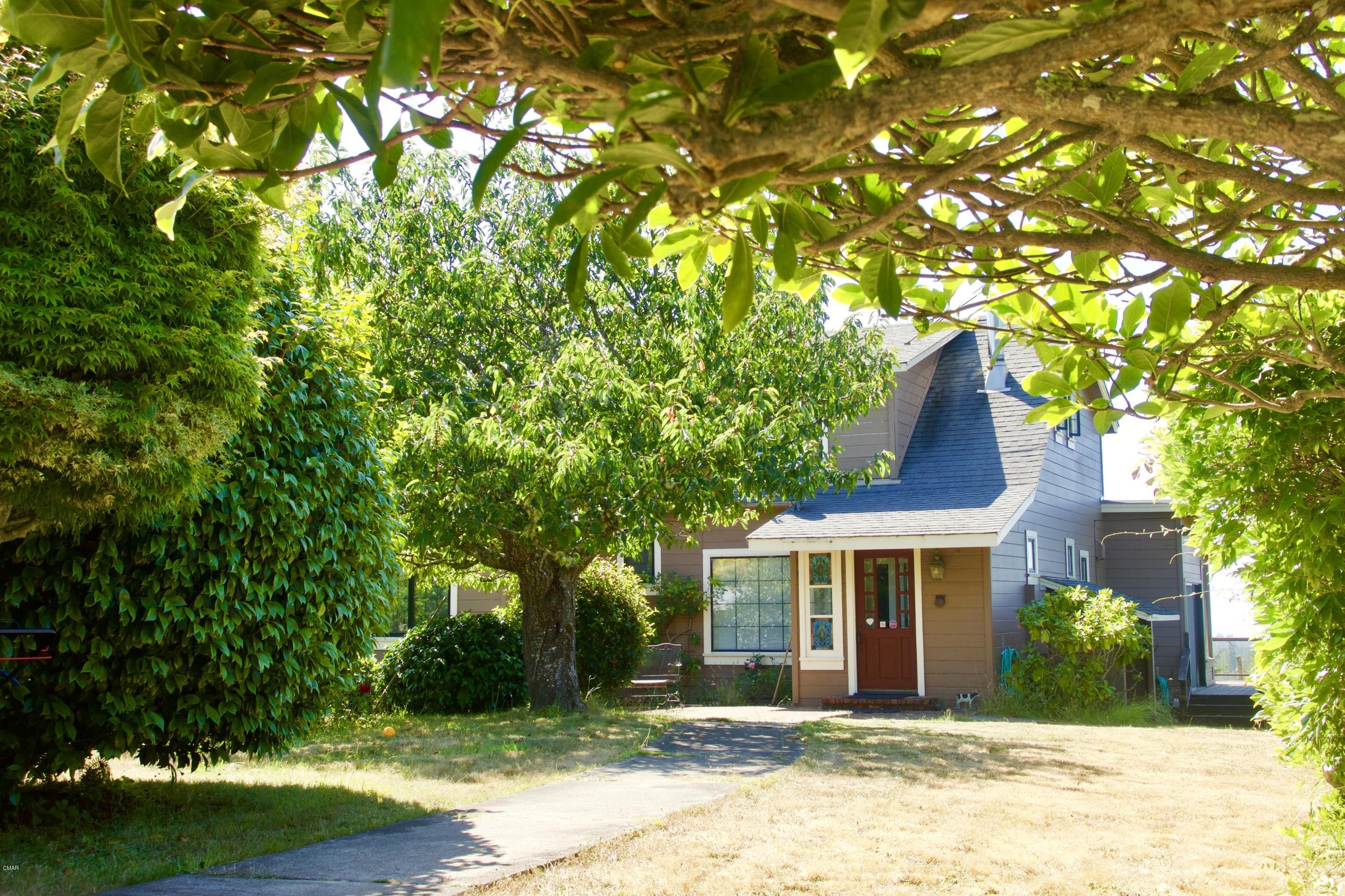 Simply amazing 40 acres of farmland, redwoods and 5 homes at the top of ''Sunshine Hill''. On a clear day views stretch all the way to the Pacific. The main home has a large kitchen with tons of storage and charm. Also a wraparound deck and sauna/hot tub room that you'll never want to leave. Each of the 4 other cottages has its own personality and are set apart for privacy. A large barn and several outbuildings offer so many uses- this could be the sustainable farm it once was, a family compound or a savvy rental income property. The iconic barn is awaiting some livestock, but currently being rented as storage space. Many varieties of fruit trees and abundant berries fill the lovely pastures. Come see Deer cottage, Meadow Cottage, Quail Cottage and Garden Cottage and prepare to fall in lov