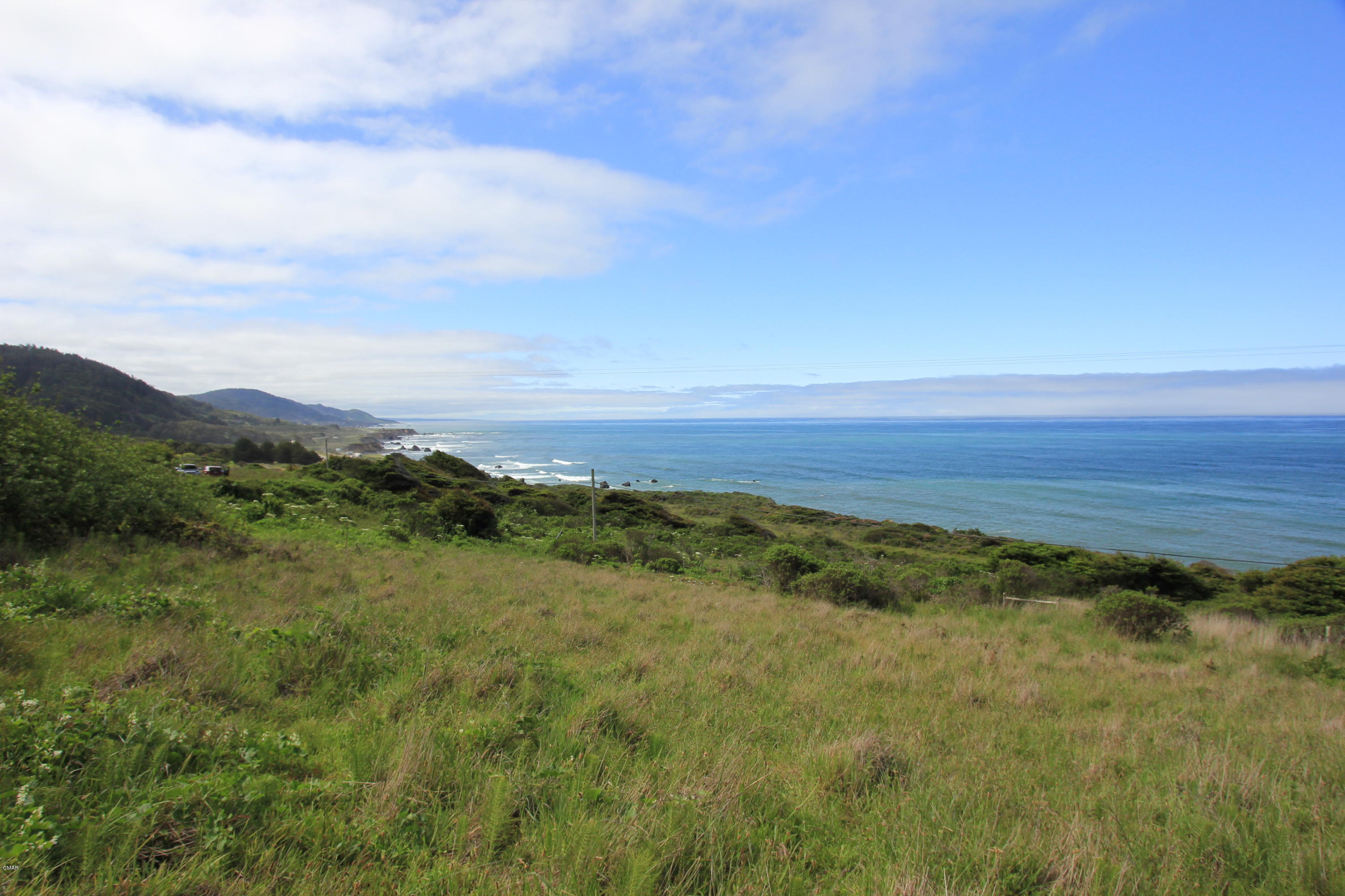 Stunning panoramic views of whales migrating the Pacific Ocean can be had from three potential building sites on this 20+ acre parcel. Venture north of the cul-de-sac and up the hill side to the first of three possible dream home sites. Relax to the sound of waves crashing on the beach below and a colony of sea lions barking from the rocks just west of the property. This location is the only one in this subdivision with no visible home sites to the north. You're only five minutes drive into the community of Westport. Fine dining is available at the Old Abalone Pub located in the Westport Hotel. Fishing and diving out of this quiet community feels like you're on a remote island. This Seascape Drive parcel is a magical place to build your dream home.