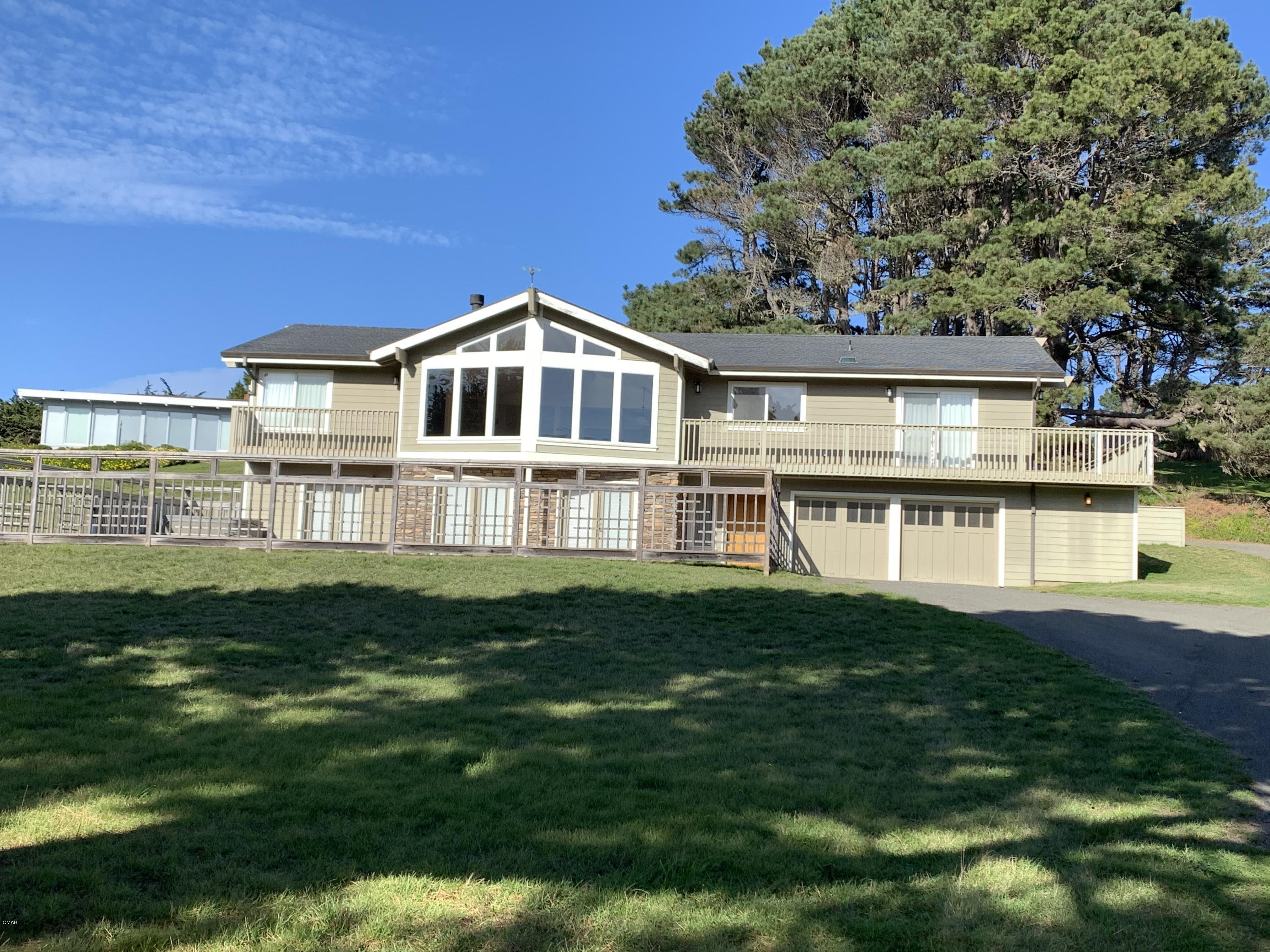 Ocean Views from almost every room, lovely home in highly desirable area. Open concept Great Room with views, kitchen features a 6 burner Viking Range, stainless steel appliances, granite counters, two sinks and a dedicated pantry. Main living area has easy access with it's own separate entrance. Great Room with stone wood burning fireplace and media room, Master Suite has a walk in closet, large master bath with gas burning fireplace, jetted soaking tub, easy access shower and dual sinks. HUGE downstairs family room with separate entrance, two French Doors to the patio and hot tub.  Downstairs has another bedroom with walk in closet and bathroom and another French Door to the patio. This home was a successful vacation rental and has MANY possibilities. New Furnace, Neighborhood has deeded