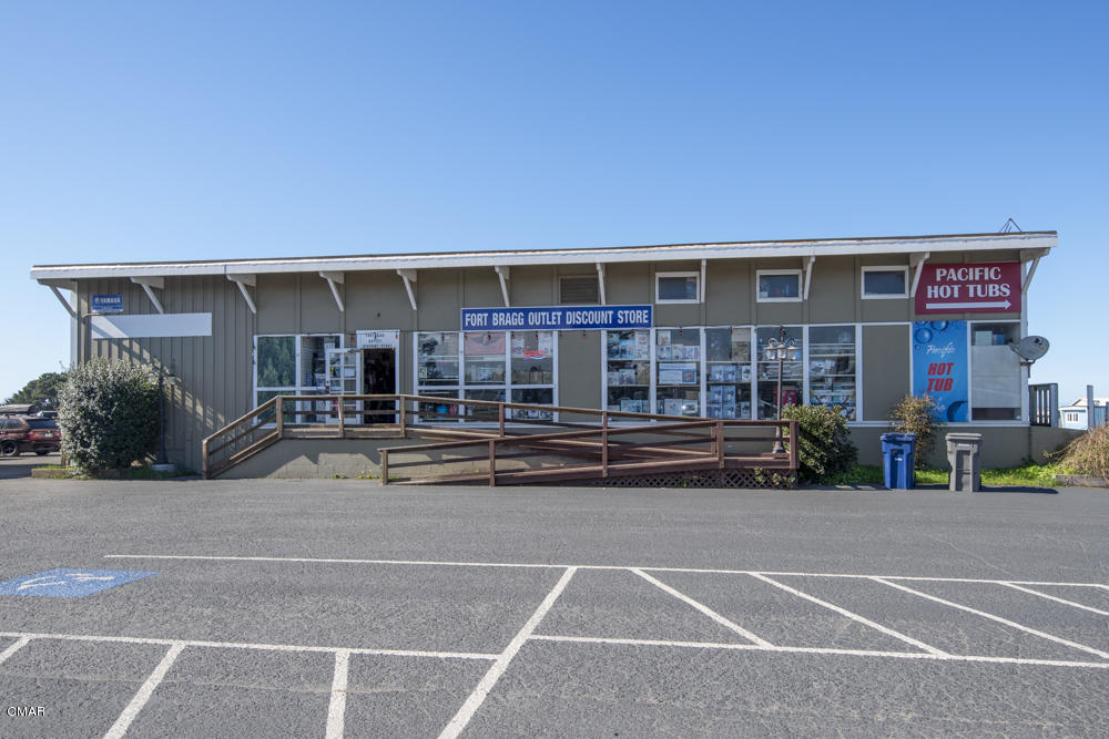 This multi unit property offers many uses. Fill the remaining unit, or use it for your own business. Paved off street parking and great highway visibility. Four spaces, two are occupied by one tenant. Two structures.Aprox 12000 square feet total. Potential uses of parking and open areas for you to develop.