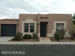 This is an awesome home that is backed up to the desert with a mountain view and lots of animal life. It is 2 bedrooms, 2 bathrooms, an Arizona room and a covered screened in back patio. There was a new Bosch dishwasher installed and Plank Laminate flooring in Master bathroom in 2018, a new gas water heater in 2017, Plank Laminate flooring in kitchen and 2nd bathroom in 2015. The gas stove and refrigerator and new carpet was put into the master bedroom in 2012. The Arizona room also has plank laminate flooring. There is a solar tube in the kitchen which really helps with lighting. This is an awesome 55+ Community with great amenities.
