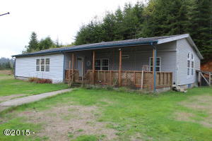 809 N S Low, Seal Rock, OR 97376 - front of home