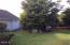 1421 NW 17th St, Lincoln City, OR 97367 - Back yard and flower garden