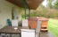 3562 NE West Devils Lake Rd, Lincoln City, OR 97367 - Covered patio and hot tub