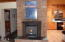 3562 NE West Devils Lake Rd, Lincoln City, OR 97367 - wood stove in brick fireplace