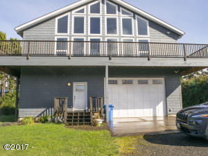 10025 NW Swallow St, Seal Rock, OR 97376 - Front of Home